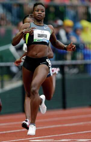 Jeneba Tarmoh finishes first in her heat in the women's 200 meters at the U.S. Olympic Track and Field Trials Thursday, June 28, 2012, in Eugene, Ore.  (AP Photo/Marcio Jose Sanchez) Photo: Associated Press