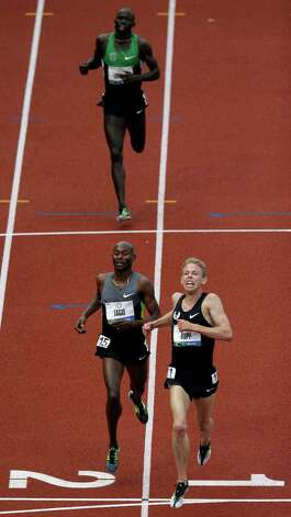 Galen Rupp and Bernard Lagat cross the finish line ahead of Lopez Lomong during the men's 5000 meter final at the U.S. Olympic Track and Field Trials Thursday, June 28, 2012, in Eugene, Ore. (AP Photo/Charlie Riedel) Photo: Associated Press