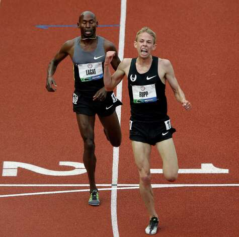 Galen Rupp reacts after crossing the finish line ahead of Bernard Lagat to win the men's 5000 meter final at the U.S. Olympic Track and Field Trials Thursday, June 28, 2012, in Eugene, Ore. (AP Photo/Charlie Riedel) Photo: Associated Press