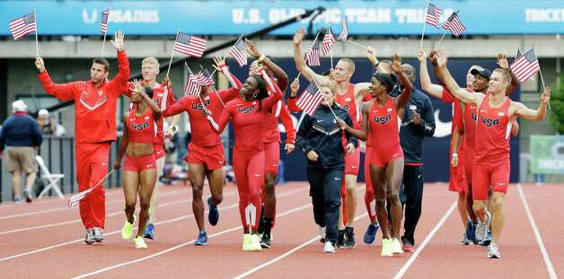 The new U.S. Olympic uniforms are debuted at the U.S. Olympic Track and Field Trials Thursday, June 28, 2012, in Eugene, Ore. (AP Photo/Eric Gay) Photo: Associated Press