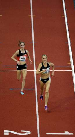 Julie Culley and Molly Huddle race to the finish line during the women's 5000 meter final at the U.S. Olympic Track and Field Trials Thursday, June 28, 2012, in Eugene, Ore. (AP Photo/Charlie Riedel) Photo: Associated Press