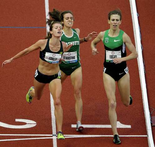 Kim Conley lunges to cross the finish line for third place past Abbey D'Agostino and Julia Lucas during the women's 5000 meter final at the U.S. Olympic Track and Field Trials Thursday, June 28, 2012, in Eugene, Ore. (AP Photo/Charlie Riedel) Photo: Associated Press