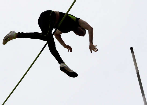 A pole vaulter competes in the final round of the men's pole vault at the U.S. Olympic Track and Field Trials Thursday, June 28, 2012, in Eugene, Ore. (AP Photo/Charlie Riedel) Photo: Associated Press