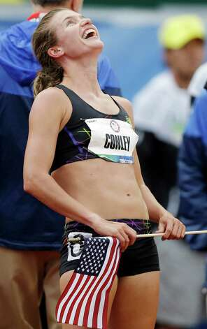 Kim Conley, reacts after seeing that her last  second push against Julia Lucas won the third and final spot on the Olympic team in the women's 5,000 meters at the U.S. Olympic Track and Field Trials Thursday, June 28, 2012, in Eugene, Ore. (AP Photo/Marcio Jose Sanchez) Photo: Associated Press