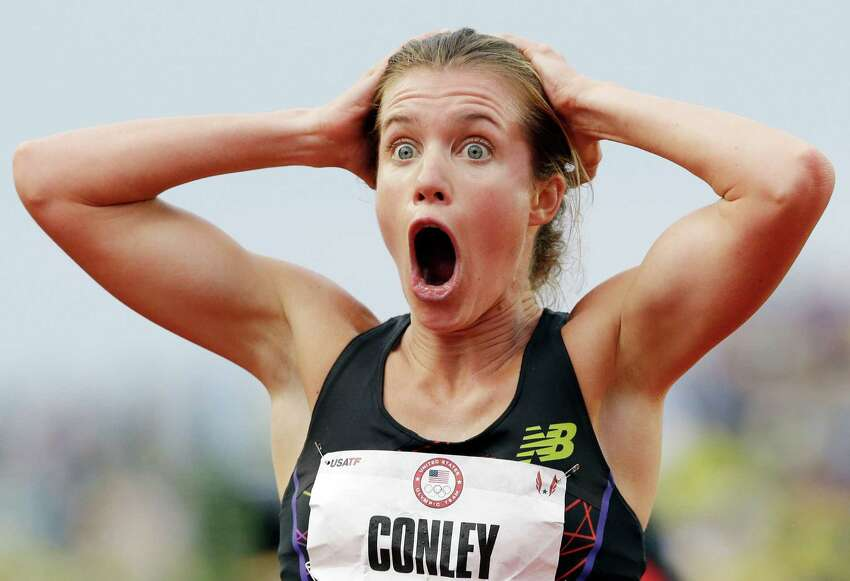 Kim Conley, reacts after seeing that her last second push against Julia Lucas won the third and final spot on the Olympic team in the women's 5,000 meters at the U.S. Olympic Track and Field Trials Thursday, June 28, 2012, in Eugene, Ore. (AP Photo/Eric Gay)