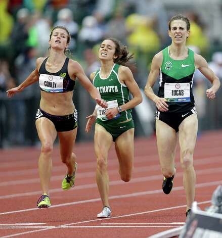 Kim Conley, left, overtakes Julia Lucas, far right, at the last second to take the third and final spot on the Olympic team in the women's 5,000 meters at the U.S. Olympic Track and Field Trials Thursday, June 28, 2012, in Eugene, Ore. (AP Photo/Marcio Jose Sanchez) Photo: Associated Press