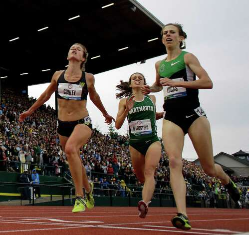Kim Conley lunges to cross the finish line for third place past Abbey D'Agostino and Julia Lucas during the women's 5000 meter final at the U.S. Olympic Track and Field Trials Thursday, June 28, 2012, in Eugene, Ore. (AP Photo/Matt Slocum) Photo: Associated Press