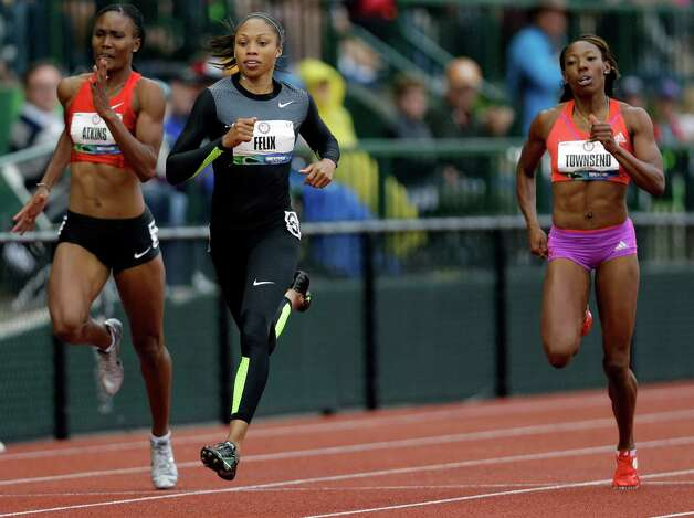 Allyson Felix finishes her heat in the women's 200 meters at the U.S. Olympic Track and Field Trials Thursday, June 28, 2012, in Eugene, Ore ahead of Joanna Atkins, left, and Tiffany Townsend. (AP Photo/Marcio Jose Sanchez) Photo: Associated Press