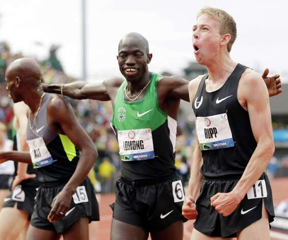 Galen Rupp, right, Bernard Lagat, left and Lopez Lomong celebrate after finishing  the men's 5,000 meter finals at the U.S. Olympic Track and Field Trials Thursday, June 28, 2012, in Eugene, Ore. ( (AP Photo/Marcio Jose Sanchez) Photo: Associated Press