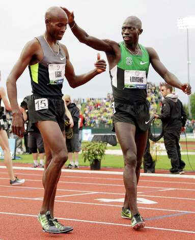 Lopez Lomong congratulates Bernard Lagat after they both finished  the men's 5,000 meter finals at the U.S. Olympic Track and Field Trials Thursday, June 28, 2012, in Eugene, Ore. Lagat finished second and Lomong finished third. (AP Photo/Eric Gay) Photo: Associated Press