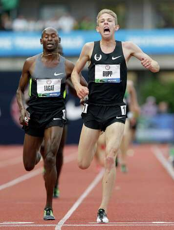 Galen Rupp celebrates after finishing first in the men's 5,000 meter finals at the U.S. Olympic Track and Field Trials Thursday, June 28, 2012, in Eugene, Ore. Bernard Lagat came in second. (AP Photo/Eric Gay) Photo: Associated Press