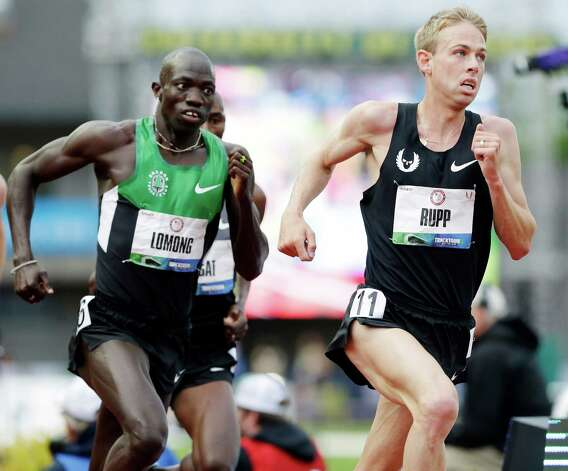 Galen Rupp leads the pack including Lopez Lomong during the men's 5,000 meter finals at the U.S. Olympic Track and Field Trials Thursday, June 28, 2012, in Eugene, Ore.  (AP Photo/Eric Gay) Photo: Associated Press