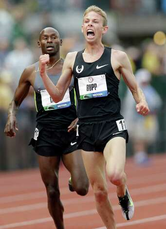 Galen Rupp celebrates after finishing first in the men's 5,000 meter finals at the U.S. Olympic Track and Field Trials Thursday, June 28, 2012, in Eugene, Ore. Bernard Lagat came in second. (AP Photo/Marcio Jose Sanchez) Photo: Associated Press