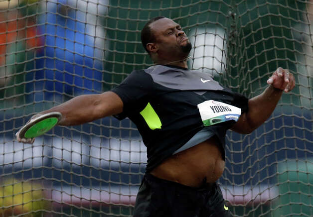 Jason Young competes in the men's discus final at the U.S. Olympic Track and Field Trials Thursday, June 28, 2012, in Eugene, Ore. Young finished third.  (AP Photo/Charlie Riedel) Photo: Associated Press