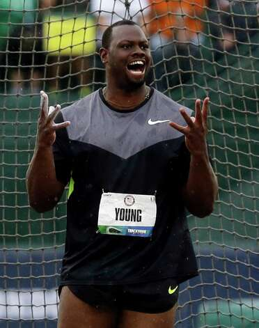 Jason Young celebrates his third place finish in the men's discus final at the U.S. Olympic Track and Field Trials Thursday, June 28, 2012, in Eugene, Ore.  (AP Photo/Charlie Riedel) Photo: Associated Press