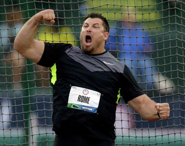 Jarred Rome celebrates his second place finish in the men's discus final at the U.S. Olympic Track and Field Trials Thursday, June 28, 2012, in Eugene, Ore.  (AP Photo/Charlie Riedel) Photo: Associated Press