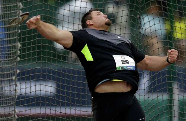 Jarred Rome competes in the men's discus final at the U.S. Olympic Track and Field Trials Thursday, June 28, 2012, in Eugene, Ore. Rome finished second.  (AP Photo/Charlie Riedel) Photo: Associated Press