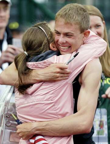 Galen Rupp hugs his wife Keara as he celebrates finishing first in the men's 5,000 meter finals at the U.S. Olympic Track and Field Trials Thursday, June 28, 2012, in Eugene, Ore. (AP Photo/Eric Gay)  (AP Photo/Marcio Jose Sanchez) Photo: Associated Press