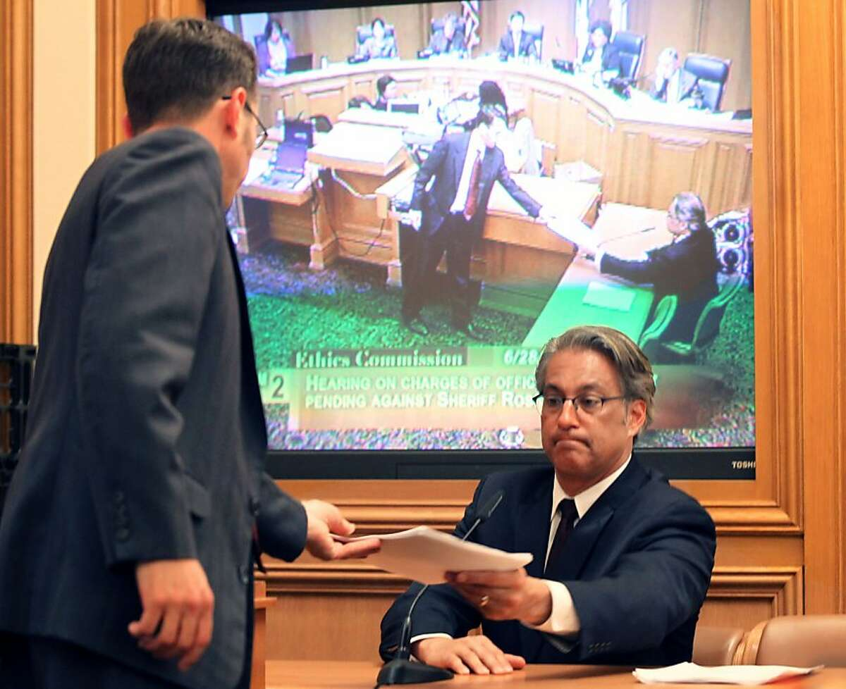 Ross Mirkarimi reaches for papers during his questioning at his Ethics Commission hearing at San Francisco City Hall Thursday June 28, 2012 in San Francisco Calif.