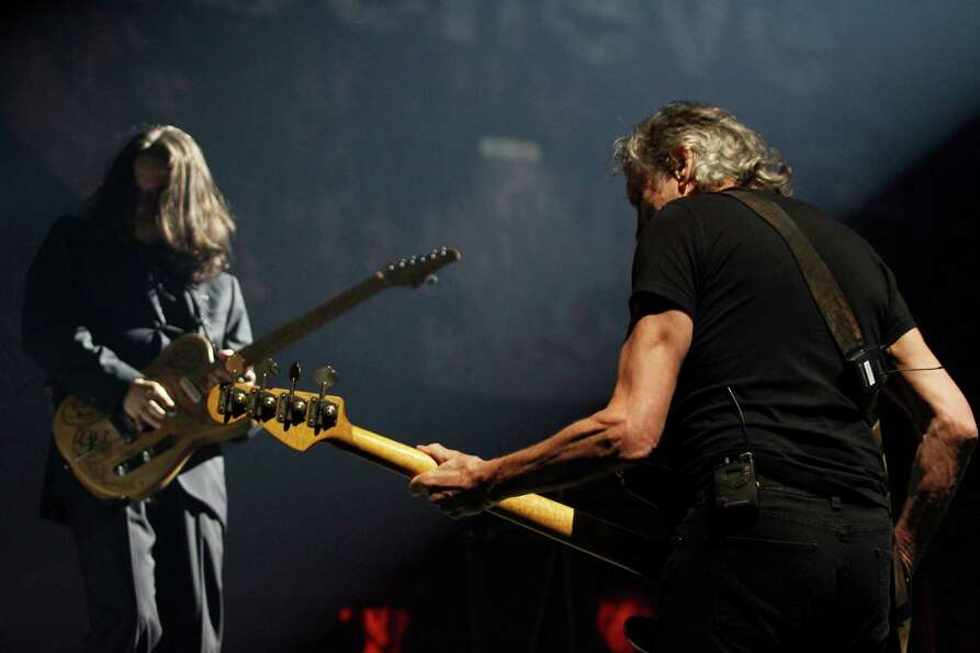 Roger Waters, right, a founding member of the band Pink Floyd, performs ?The Wall? Live at the Times
