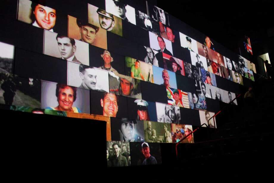 "Images are projected onto the wall as a part of the performance of ""The Wall"" Live at the Times Union Center in Albany, N.Y. on Thursday, June 28, 2012. (Dan Little / Special to the Times Union) Photo: Dan Little / Copyright: All Rights Reserved Brett Carlsen"