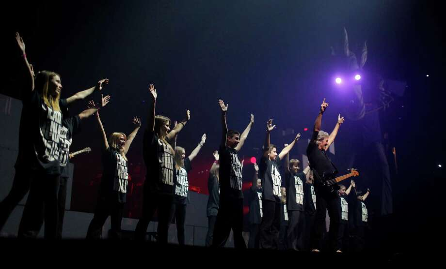 Youths perform on stage with Roger Waters, a founding member of the band Pink Floyd, at ?The Wall? Live at the Times Union Center in Albany, N.Y. on Thursday, June 28, 2012. (Dan Little / Special to the Times Union) Photo: Dan Little / Copyright: All Rights Reserved Brett Carlsen