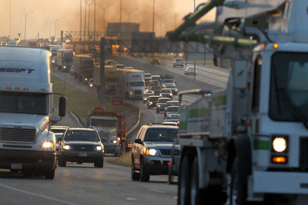 Smoke fills the air as traffic backs up on IH-35 southbound Friday morning June 29, 2012 near FM 3009 after a truck carrying meat crashed there about 12:30 a.m. . The driver was not injured.