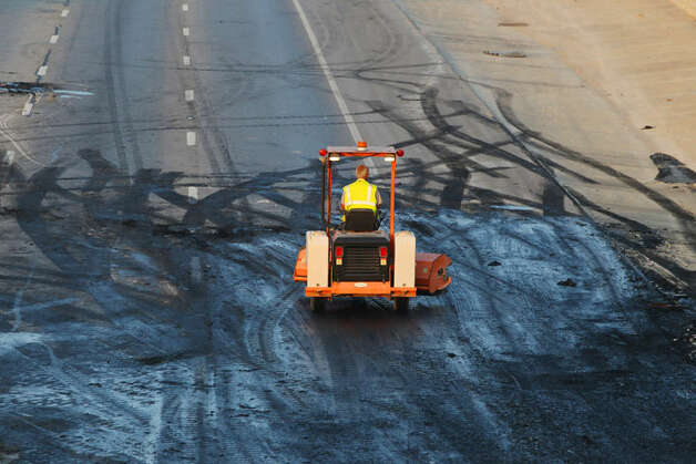 A man driving a sweeper starts to clean up on IH-35 southbound near FM 3009 after a truck carryiing meat crashed there about 12;30 a.m. . The driver was not hurt and traffic in the area has been diverted off of the freeway for hours. John Davenport/San Antonio Express-News