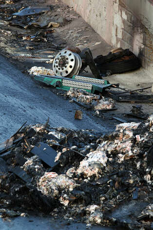 Charred debris is on the side of IH-35 southbound near FM 3009 after a truck carrying pork crashed and burned about 12:030 a.m. early Friday  June 29, 2012. The driver was not injured and traffic in the area has been diverted off of the interstate for hours. John Davenport/San Antonio Express-News