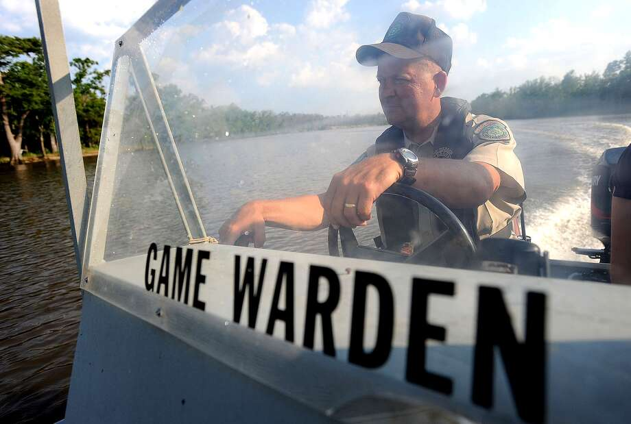 Mike Boone, game warden for the TPWD, patrols the Neches River looking for boaters violating safety laws. Guiseppe Barranco/The Enterprise Photo: Guiseppe Barranco / Beaumont