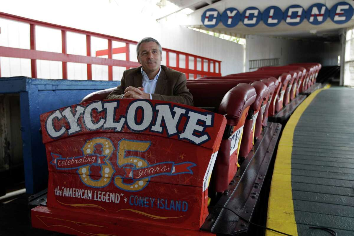 In a Tuesday, June 26, 2012 photo taken on Coney Island in New York, Valerio Ferrari, President of Central Amusement International, is interviewed while sitting in the one of the Cyclone roller coaster cars.