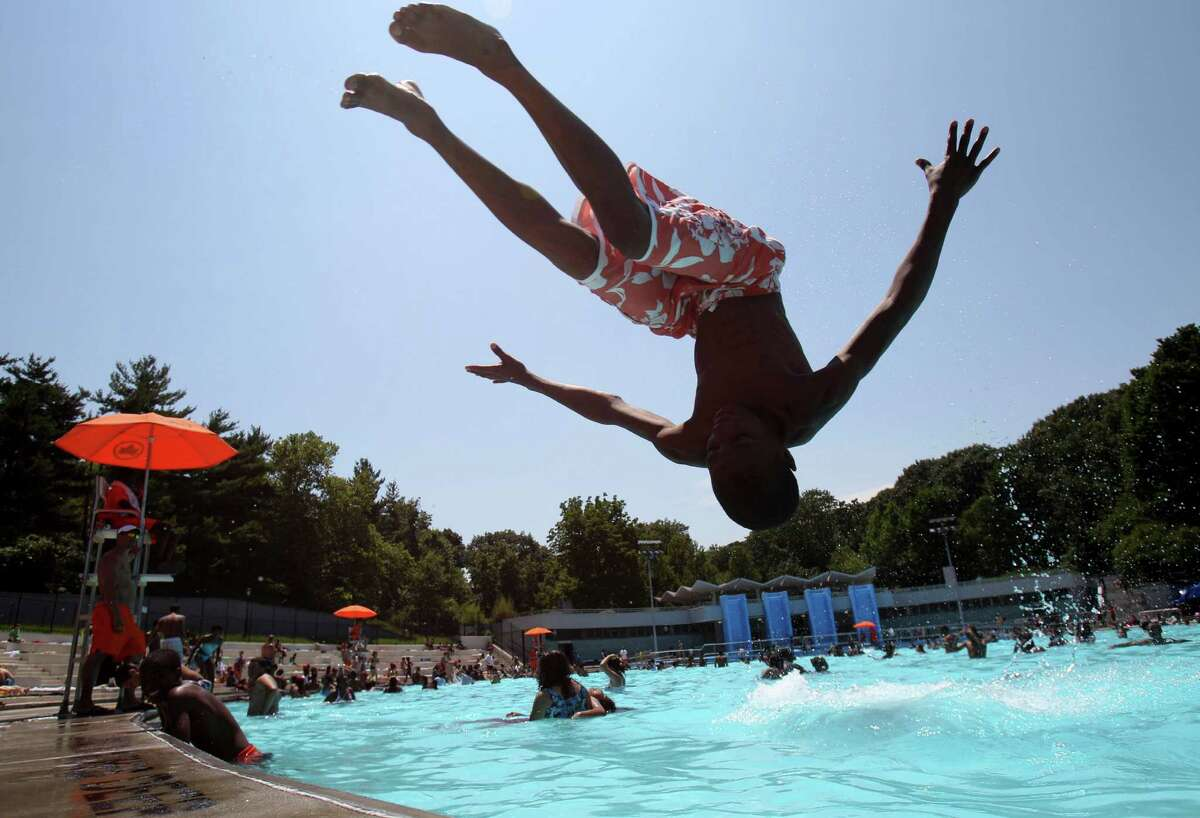 Terrill Shepard, 16, jumps into Lasker Pool in New York, Thursday, June 28, 2012. The city's 55 outdoor pools opened to the public for the season on Thursday.