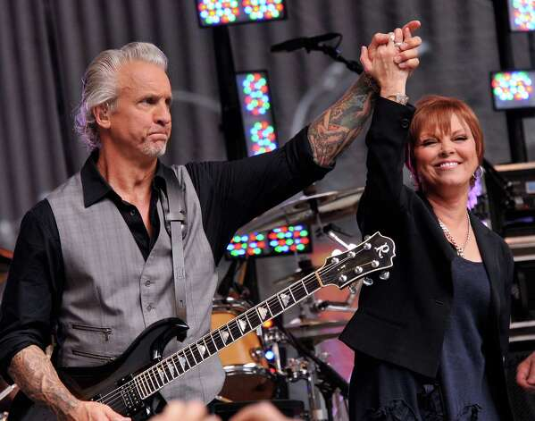 """NEW YORK, NY - JUNE 29:  Musician Neil Giraldo and singer Pat Benatar perform during """"FOX & Friends"""" All American Concert Series at FOX Studios on June 29, 2012 in New York City. Photo: Stephen Lovekin, Getty Images / 2012 Getty Images"""
