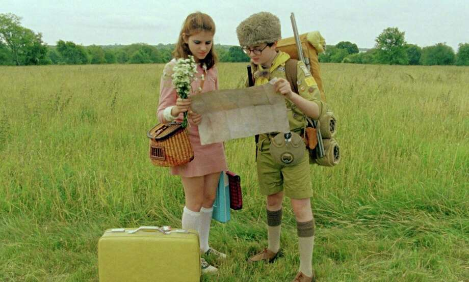 "In ""Moonrise Kingdom,"" Suzy (Kara Hayward) runs away with Sam (Jared Gilman) and brings along her favorite books in a yellow suitcase. Photo: Courtesy Of Focus Features"