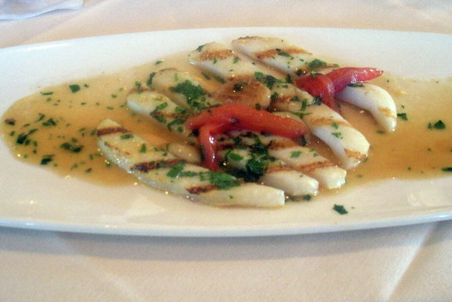 Shared dish at Bin 100, in Milford, Conn. : calamari steak. Photo: Lee Steele / Connecticut Post