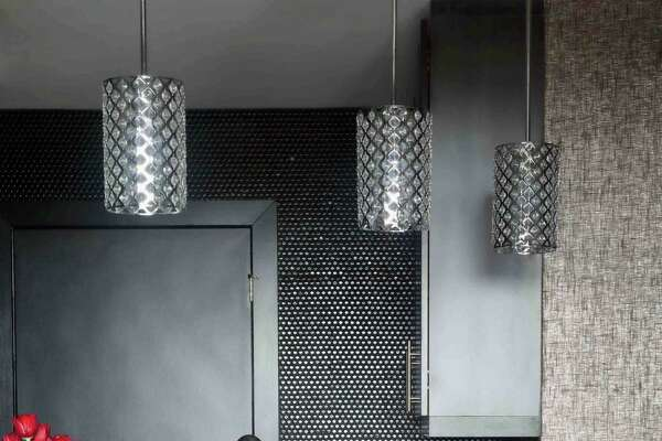 The same tile used on a backsplash also is used throughout the walls of this kitchen.