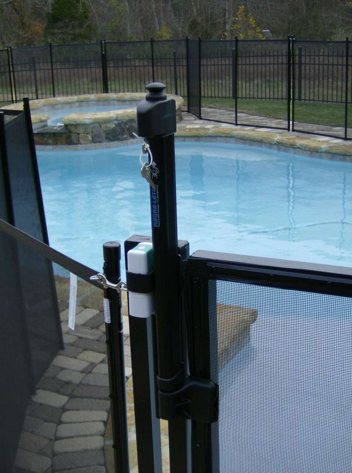 An alarm on the swimming-pool gate will sound in the house when the gate is opened.
