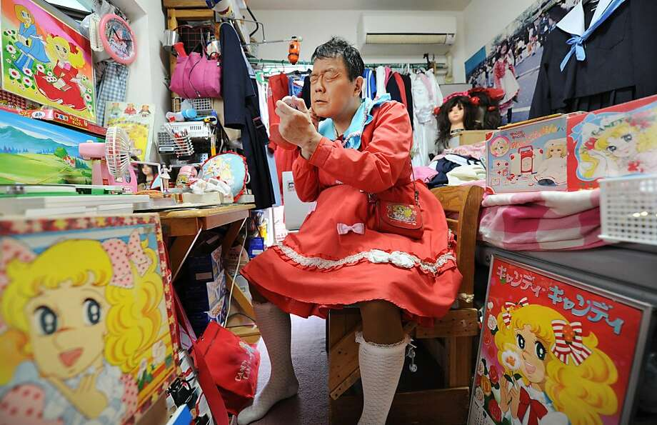 The 'Candy' man: Yuzo Shiozawa applies makeup after dressing up 