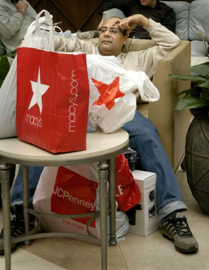 Kaushik Mitra of Newtown rests with his packages at the Danbury Fair Mall Black Friday, November 27, 2009 Photo: Carol Kaliff / The News-Times