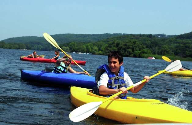 Twelve-year-old Christian Iannucci, of Ansonia, kayaks on the Housatonic River with other campers from The Recreation Camp in Derby, Conn. Friday, June 29, 2012. Photo: Autumn Driscoll / Connecticut Post