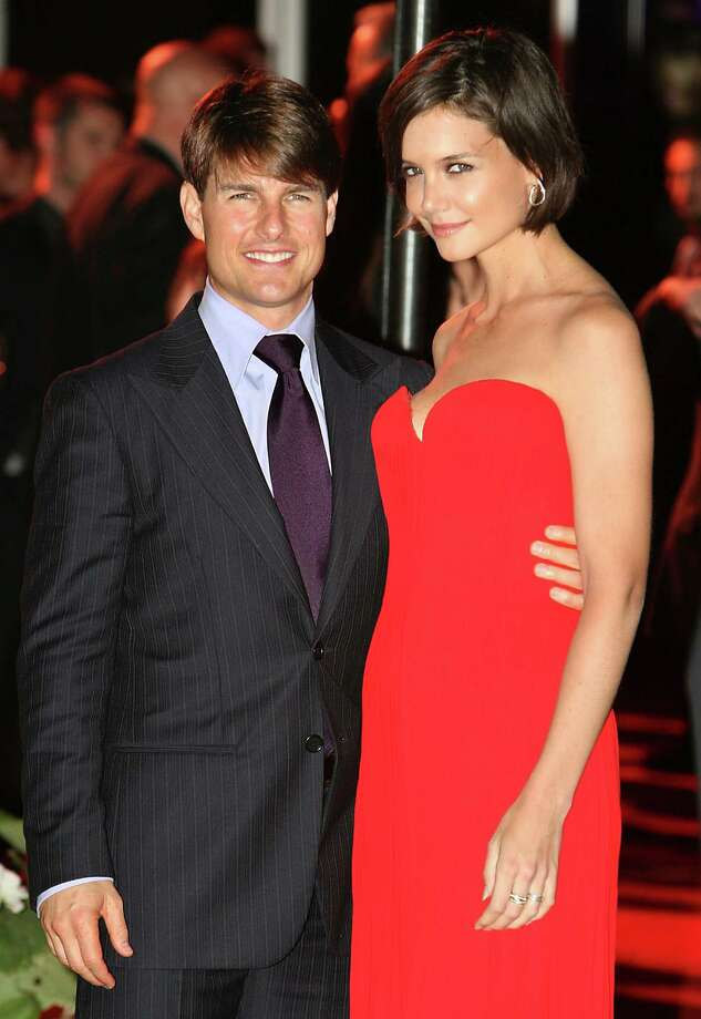 Co-hosts Tom Cruise and Katie Holmes pose for photographers at a private party in honor of Victoria and David Beckham at the Museum of Contemporary Art, Sunday, July 22, 2007, in Los Angeles. Photo: Rene Macura, AP / AP