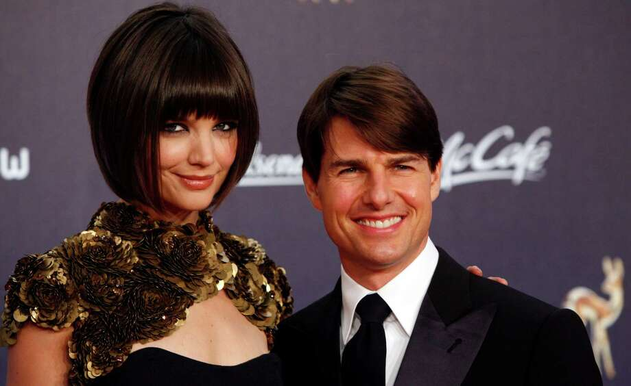 Tom Cruise, right, and Katie Holmes pose for the  photographers  on the red carpet prior to the Bambi media award ceremony in Duesseldorf, western Germany, in this  Nov. 29, 2007 file photo.  Photo: Miguel Villagran, AP / AP