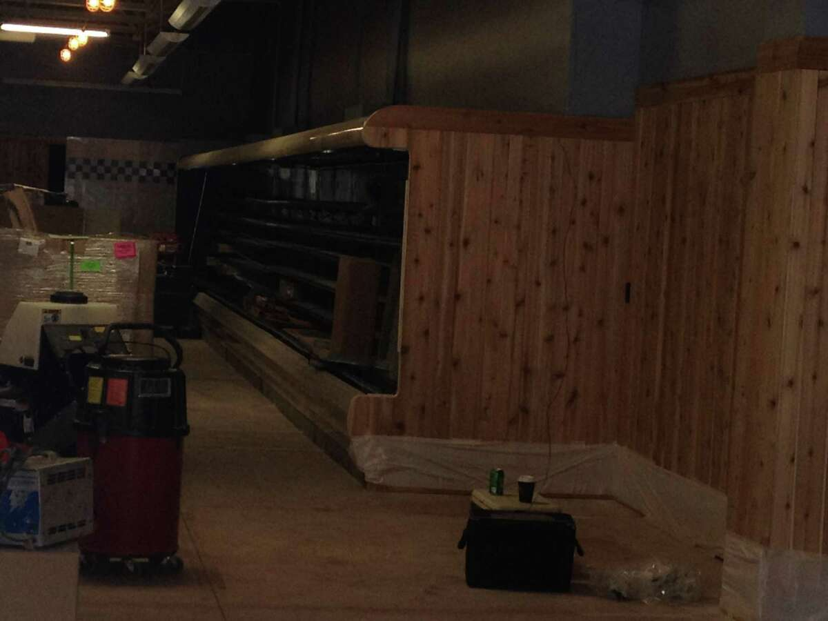 A refridgerator case can been seen from the front entrance of the Trader Joe's grocery store that is being built on Wolf Road in Colonie. (Times Union)