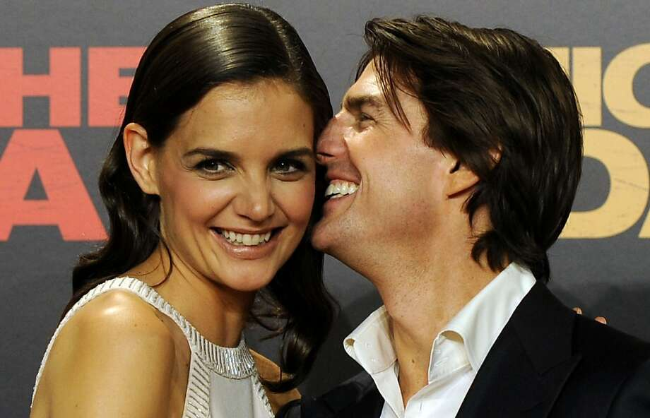 "(FILES) Photo dated June 16, 2010 shows US actors Tom Cruise and his wife Katie Holmes on the red carpet as they arrive for the international film premiere of the film ""Knight and Day"" by US director James Mangold in Sevilla. Cruise and Holmes are divorcing, People magazine reported on June 29, 2012.      AFP PHOTO/FILES/CRISTINA QUICLERCRISTINA QUICLER/AFP/GettyImages Photo: Cristina Quicler, AFP/Getty Images"