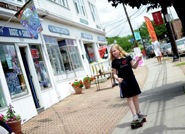 Eleven-year-old Shayla Saylor rides her skateboard down Fairfield Avenue in the Black Rock section of Bridgeport Saturday, June 2, 2012.  Saylor, who lives in Black Rock, said she rides her skateboard when she is happy.  Sometimes she will ride all day, she added. Photo: Autumn Driscoll / Connecticut Post