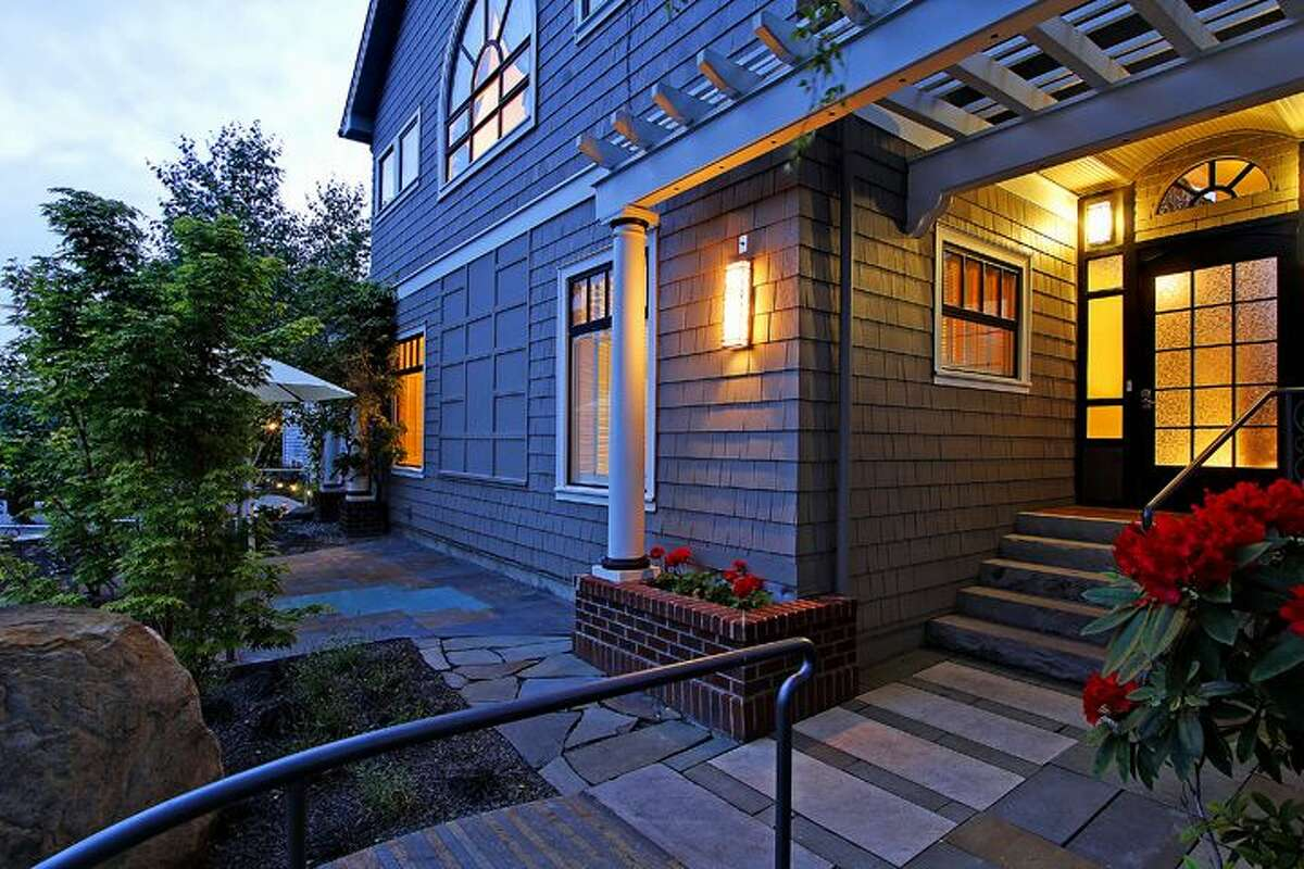 Entry of 1606 Bigelow Ave. N.. The 4,000-square-foot house, built in 1912, has four bedrooms and 2.75 bathrooms, an elevator, skylights, indoor and outdoor spa, hi-tech media room, three-car garage and views of downtown and Lake Union on a 5,500-square-foot lot. It's listed for $1.85 million.