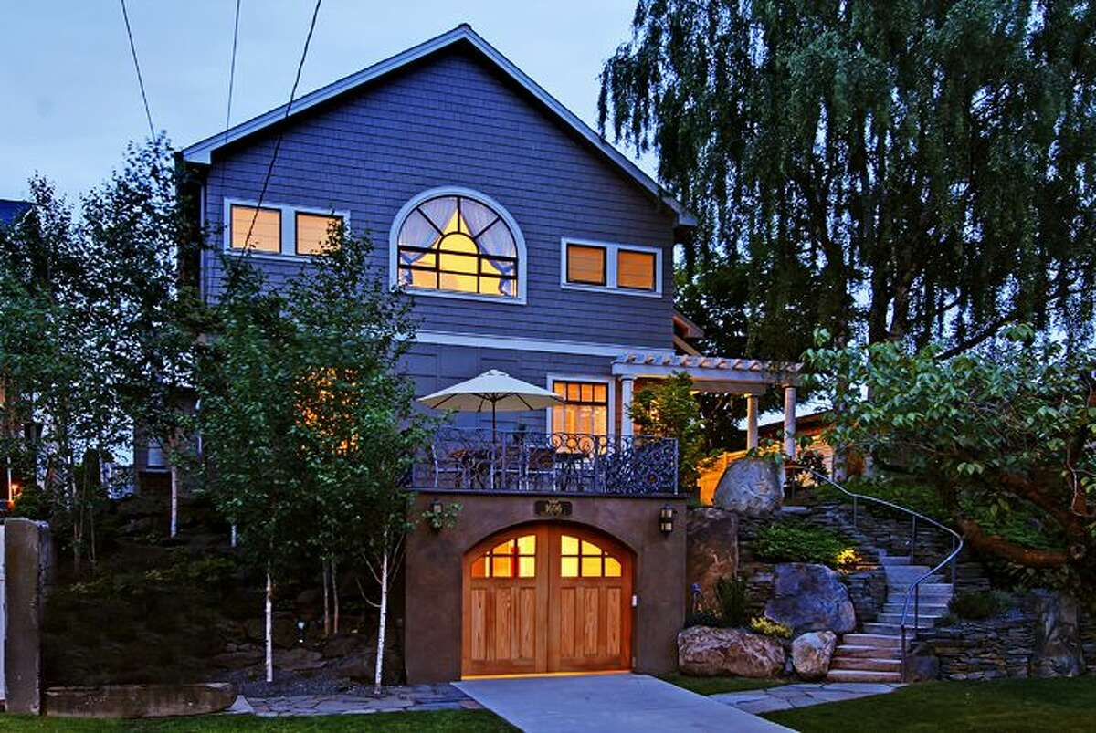 This week's spotlight home was built in 1921 but has been extensively, artistically remodeled. The house, 1606 Bigelow Ave. N., in Queen Anne, is 4,000 square feet, with four bedrooms and 2.75 bathrooms, including a massive master suite with skylights, a wall of retractable windows, a deck and an indoor-outdoor fireplace. There's also artistic railings, French doors, an elevator, skylights, indoor and outdoor spa, hi-tech media room, three-car garage and views of downtown and Lake Union on a 5,500-square-foot lot. It's listed for $1.85 million. An open house is scheduled for 1 p.m. to 4 p.m. on Sunday, July 1.