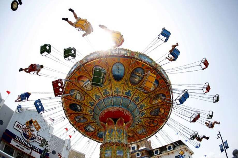 $21.99:An all-day ride pass at the Pleasure Pier, where you can ride the Gulf Glider.    (Houston / Associated Press)