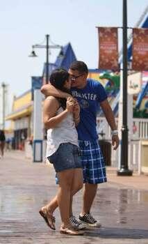 Walking on the Pleasure Pier.  (Karen Warren / Houston Chronicle)