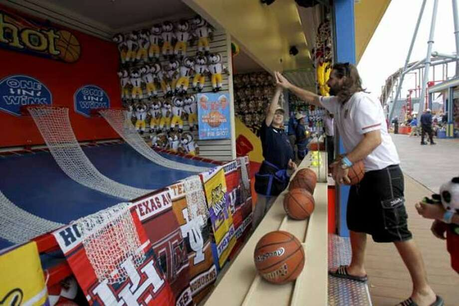 $3:To take one basketball  shot at a prize on the new Pleasure Pier.   (Karen Warren / Houston Chronicle)